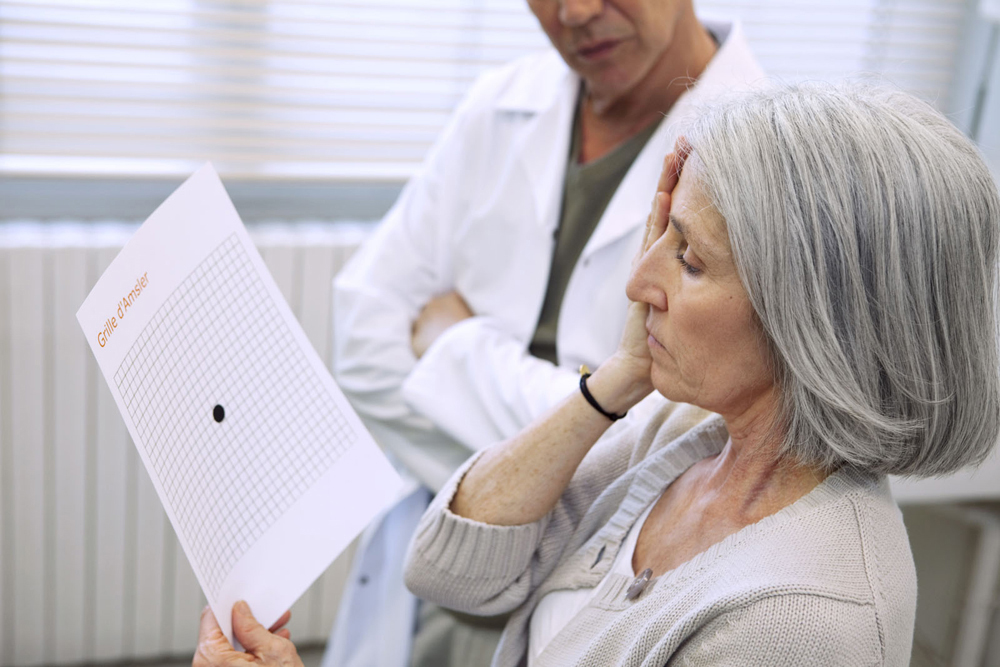 Optometrist checking for macular degeneration